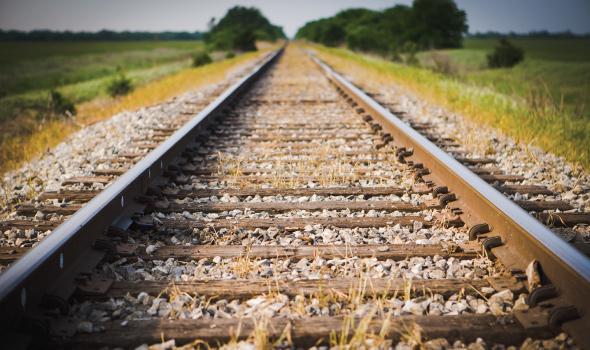 Train tracks and green pasture
